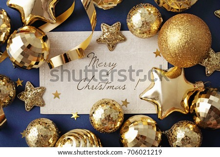 blank card and gold christmas ornaments on navy blue background frame - Navy And Gold Christmas Decorations