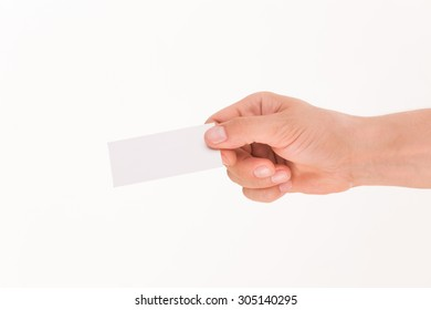 Blank card is handed by man isolated on white background. Man giving hand to someone with his right hand.