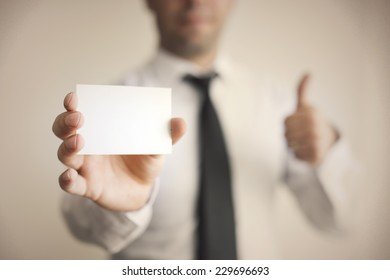 Blank Card holded by hand and thumbs up
