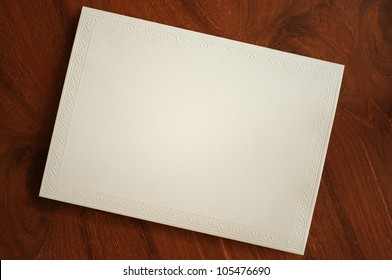 blank card with thai traditional pattern on wooden desk