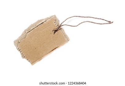 Blank cardboard price tag tied with string isolated on white background, top view
