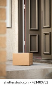 a blank carton box is delivered at front door