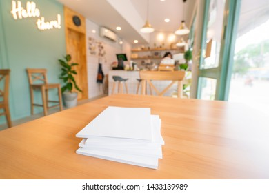 Blank catalog, magazines,book mock up on wood table.