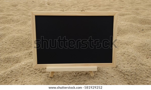 blank chalkboard on sandy beach. Composition of Nature.