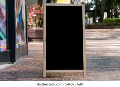 Blank Chalkboard Sign on a City Sidewalk