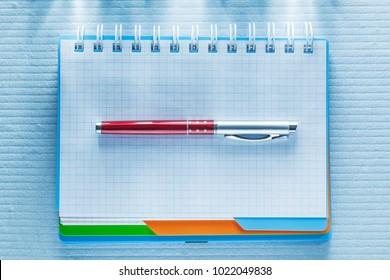 Blank checked notepad biro pen.