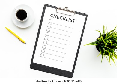 Blank checklist with space for ticks on pad on office desk. Checklist for office worker, manager, businessman, chief on white background top view