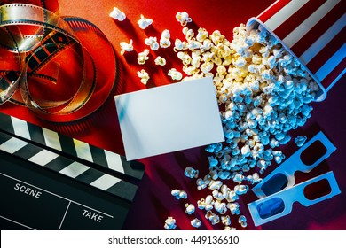 Blank cinema promo card or ticket, popcorn, filmstrip and clapper, movies and entertainment concept - Shutterstock ID 449136610