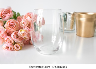 Blank clear stemless wine glass with pink roses and gold bucket, wedding glass mockup