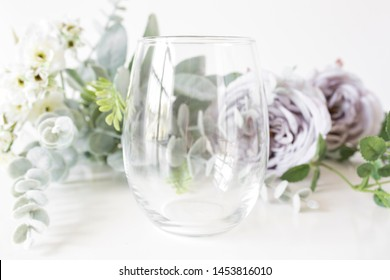 Blank clear stemless wine glass with purple roses, wine glass mockup