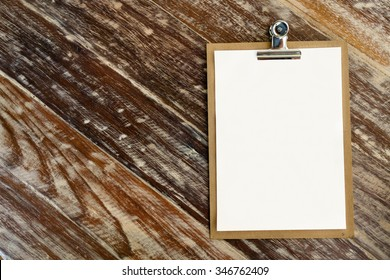 Blank clip on menu on wooden background