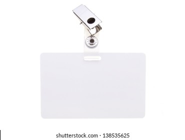 Blank clip on name tag with copy space isolated on white.