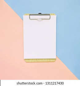 Blank clipboard on pastel color background, minimal style