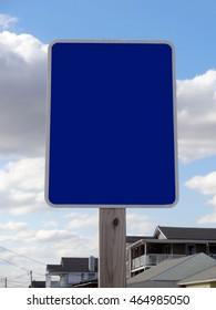 Blank Coastal Blue Sign against a Blue Sky