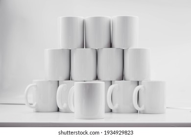 Blank coffee cup in white background on muck up
