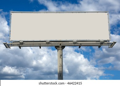 Blank commercial billboard against cloudy sky