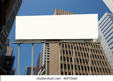 Blank commercial billboard city and tale building on background  background
