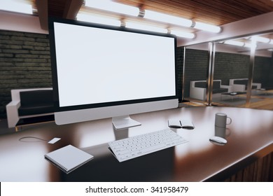 Blank computer desktop with coffee mug, diary and other accesories in modern loft room, mock up 3D Render