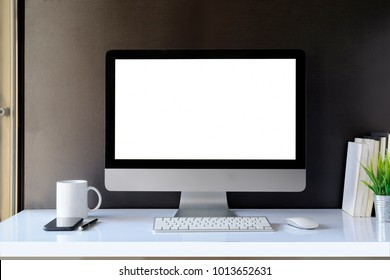 Blank computer desktop with keyboard, coffee mug and other accessories