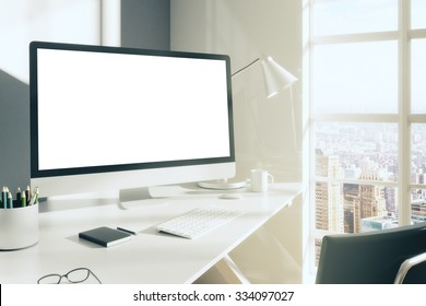 Blank computer desktop with keyboard, diary and other accesories on white table in sunny room, mock up