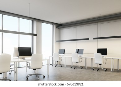 Blank computer screens standing on a desk in a white office with large windows. Concept of a successful company. 3d rendering mock up