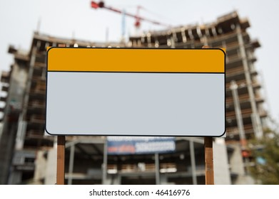 Blank construction sign against construction site