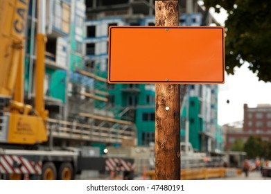 Blank construction sign on a electric wooden pole construction site on background