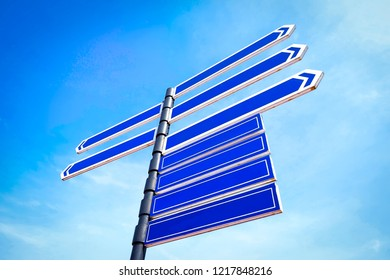 Blank copy space arrow signage with blue sky background