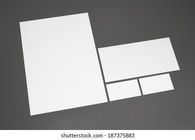 Blank corporate identity package business cards envelope and letter with clear gray background.