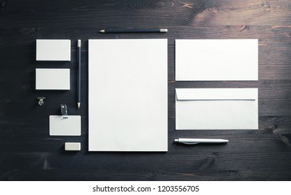 Blank corporate identity template on wooden background. Photo of blank stationery set. Mockup for design presentations and portfolios. Top view. Flat lay.