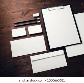 Blank corporate identity template on wooden background. Responsive design mockup.