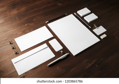 Blank corporate stationery set on wooden background. Template for branding identity.