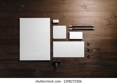 Blank corporate stationery set on wooden background. Branding mock up. Flat lay.