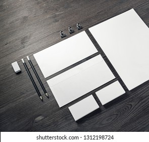 Blank corporate stationery set on wooden background. Template for branding design.