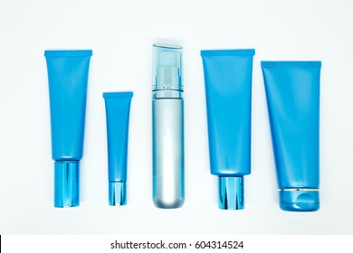 Blank cosmetic tubes on white background. blue color. Place for your text.