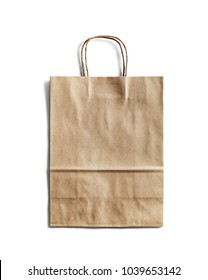 Blank craft paper bag on white background. Responsive design mockup. Isolated with clipping path.
