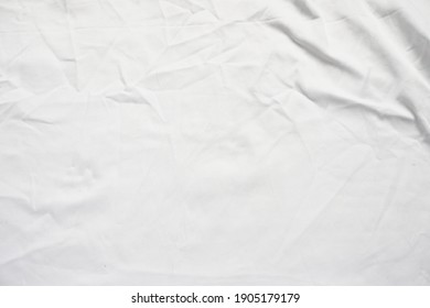 blank crumpled white bedsheet for background