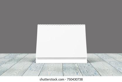 Blank desk calendar on wooden desk. As Mockup Template.