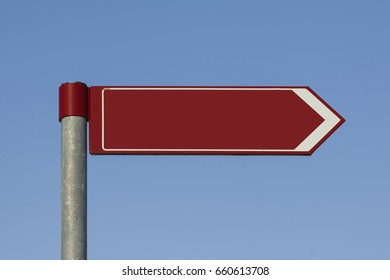 Blank direction sign on a post