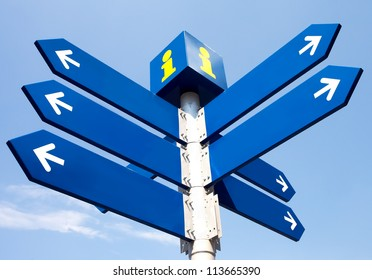 Blank directional road signs over blue sky