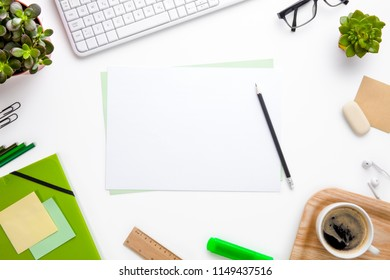Blank Documents Surrounded With Office Equipment On White Desk