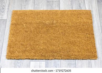 Blank door mat on grey vinyl floor