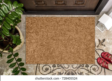 Blank doormat before the door in the hall. Mat on ceramic floor, flowers and red shoes. Welcome home, product Mockup