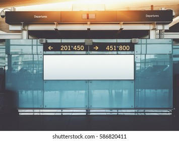 Blank electronic departures and arrival informational billboard with clean space for publicity content or text message, narrow advertising mock up in interior, public commercial board in airport hall