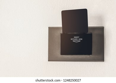 blank electronic key card on wall background