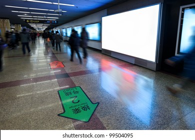 blank electronic screen on the wall in subway station channel
