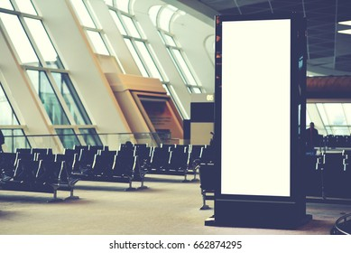 Blank empty digital billboard for your advertising on publicity content in airport waiting hall. Mock up electronic media board with copy space for your design information in terminal interior