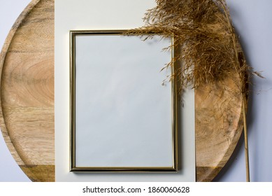 Blank, empty frame mockup on round wooden plate. Dry grass, reed in background. Modern template. Branding identity. Natural autumn, fall design. Flat lay, top view