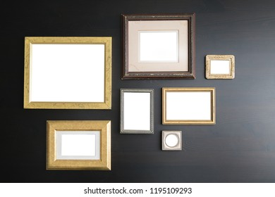 Blank empty frames on dark wooden background. Art gallery, museum exhibition white clipping path