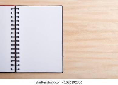 Blank empty notebook over wooden background